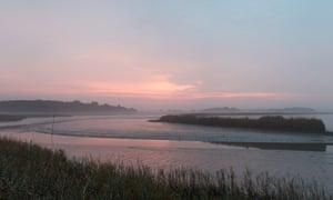 The Alde river estuary near Snape Maltings at sunrise.