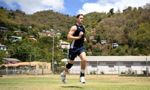 England's Chris Woakes runs into bowl during a nets session at Queen's Park in Grenada on Sunday.