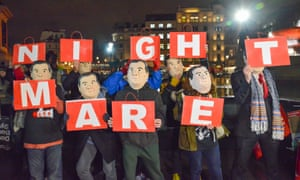 Protesters in London donned Osborne masks ahead of the spending review.