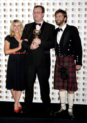 Russell T Davies (centre) with Doctor Who stars Billie Piper and David Tennant after winning a Bafta in 2006.