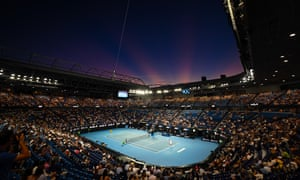 The crowd at the Rod Laver Arena as darkness falls.