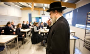 The head of Yesodey Hatorah school in a class with pupils