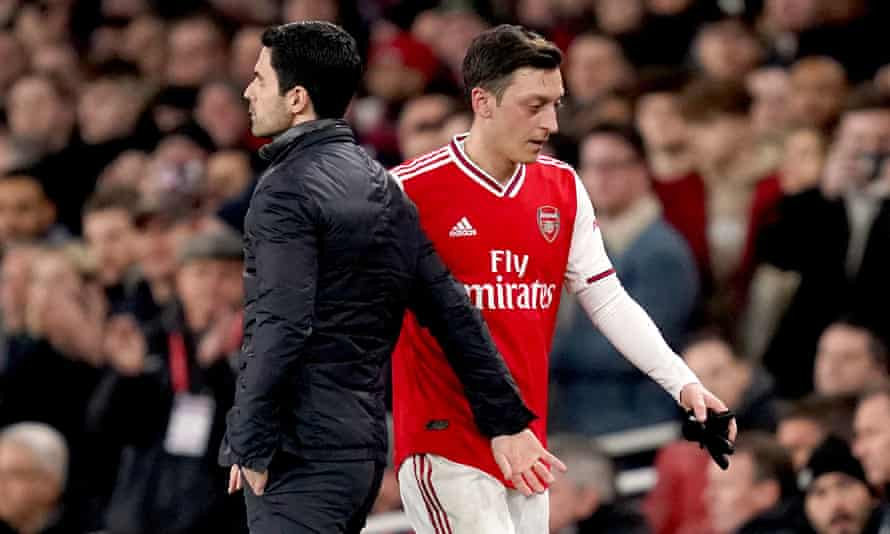 Mikel Arteta with Mesut Özil last February. The manager says he wants to 'try to find the best solution for everyone'.