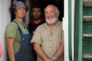 Greenpeace staff Beate Lochhaas and Sakis Manisiotis with Roger Grace on the deck of the Rainbow Warrior, in 2006