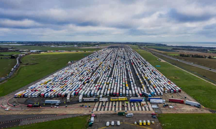 Thousands of lorries parked at Manston airport in Kent on Christmas Eve as drivers await Covid tests.
