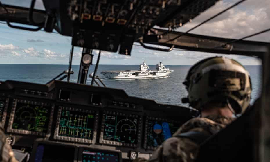 HMS Queen Elizabeth as seen through the cockpit of a Merlin helicopter before landing on the aircraft carrier during trials off the east coast of the USA.