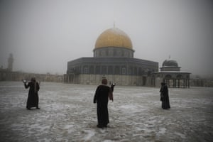 Jerusalem, Israel. Women have a snowball fight at the Dome of the Rock mosque in the Al Aqsa mosque compound in the Old City