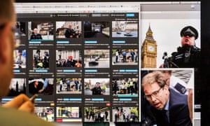 A Guardian picture editor sorts through images of the Westminster attack as they arrived from the scene on Wednesday.