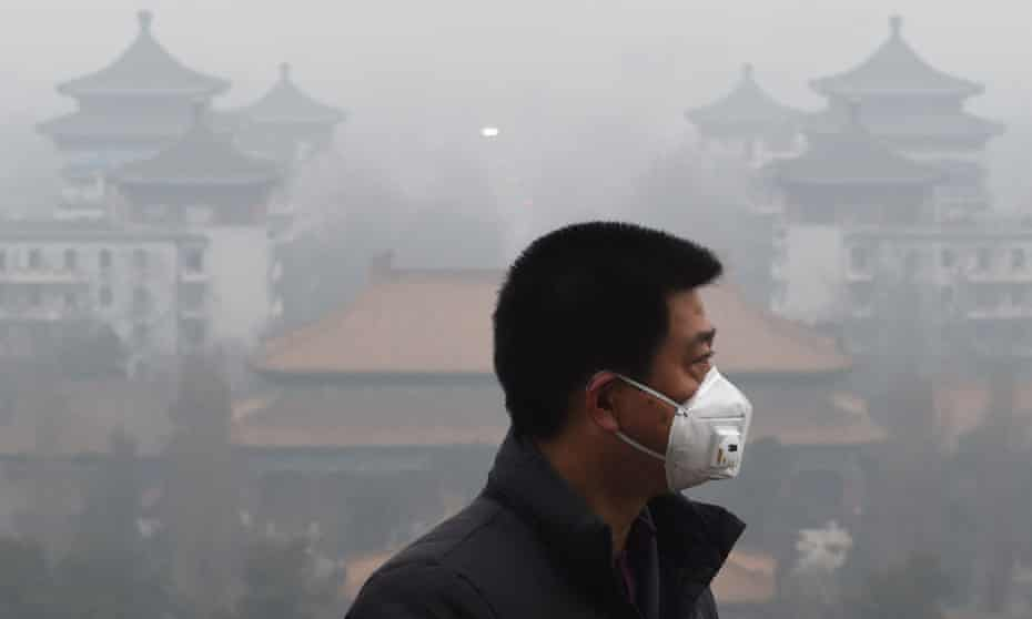 A man wears a mask to protect himself from air pollution in Beijing .