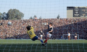 Scotland's Kenny Dalglish volleys the ball past Holland's goalkeeper Jan Jongbloed to score.
