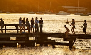 People jumping into Swan River from Bicton Jetty, Bicton. Perth, Western Australia, Australia.