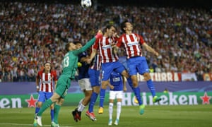 Atlético goalkeeper Jan Oblak punches the ball away.