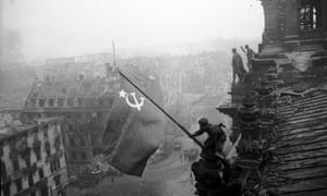 Soldiers raising the Soviet flag over the Reichstag in 1945.