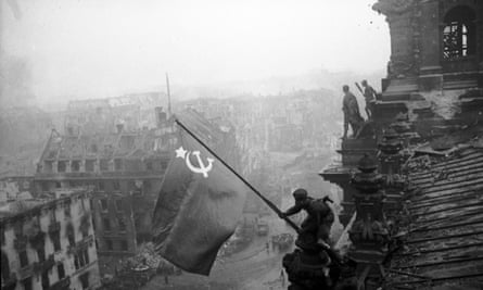 Red army soldiers raising the Soviet flag over the Reichstag in Berlin on 30 April 1945.