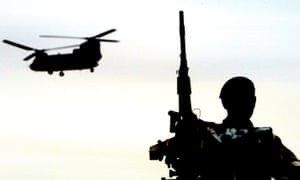 A soldier and a Chinook helicopter