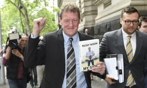 Ricky Nixon holds a copy of his book, My Side.