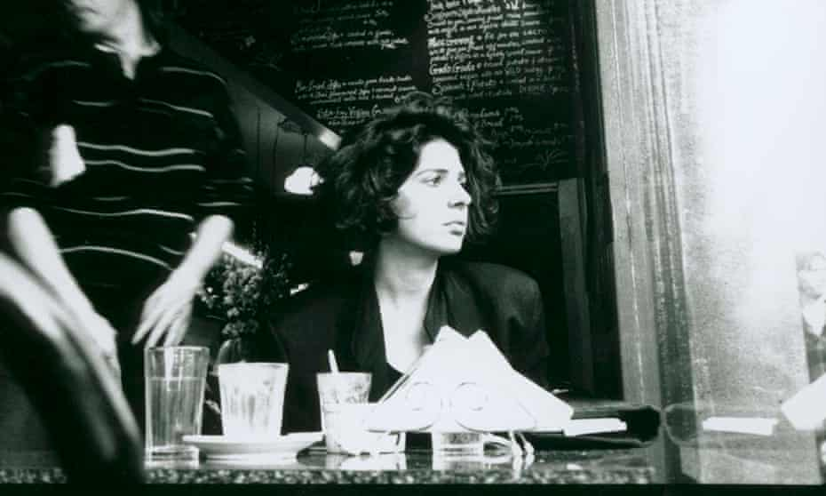 Photograph of a young woman dining at a cafe in Melbourne.