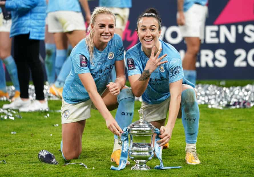 Alex Greenwood and Lucy Bronze celebrate finally winning the FA Cup with Manchester City in November