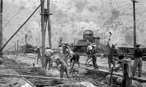 Labourers working on the restoration of Hiroshima's Aioi Bridge in 1949.