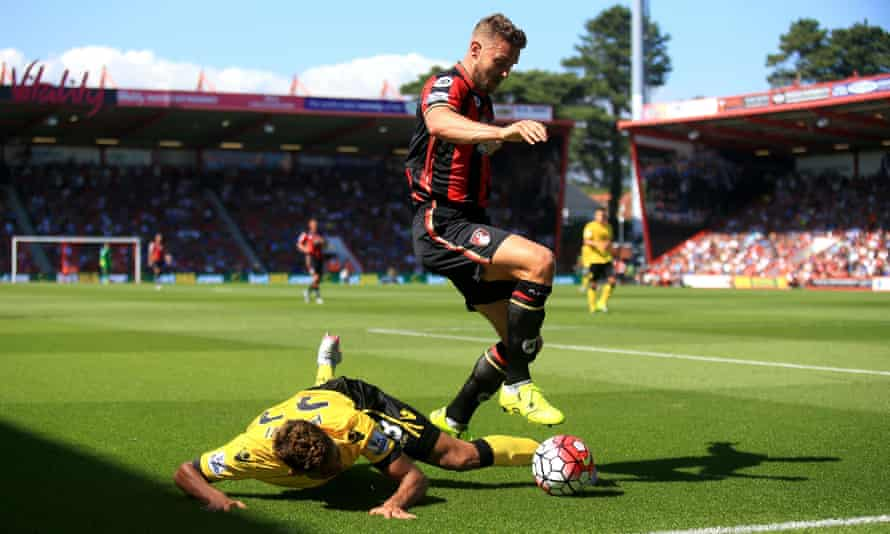 Bournemouth's Simon Francis tangles with Aston Villa's Jordan Amavi