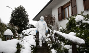 Doctor Luigi Cavanna leaves a Covid-19 patient's home in Monticelli d'Ongina, near Piacenza, Italy.