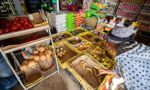 A South African buys a single banana in a small shop in Masiphumelele, Cape Town. Two quarters of shrinking GDP places South Africa in a technical recession.