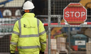 A Carillion worker next to a stop sign