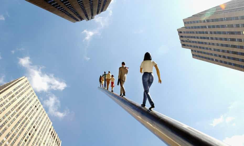 Artist Jonathan Borofsky's sculpture Walking to the Sky rises 100 feet above Rockefeller Center in New York City.