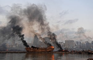 A ship is in flames at the port of Beirut following the massive explosion that hit the heart of the Lebanese capital.
