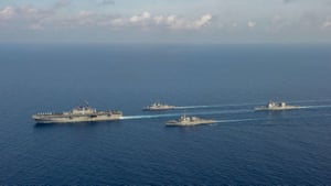 Amphibious assault ship USS America, Royal Australian navy helicopter frigate HMAS Parramatta, guided-missile destroyer USS Barry and guided-missile cruiser USS Bunker Hill conduct manoeuvres in the South China Sea.