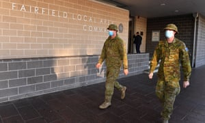 Australian Defence Force personnel are seen at Fairfield Police Station in the south west suburb of Sydney, Australia, 2 August.