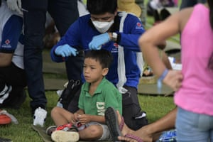 Survivors of the 7.8-magnitude quake that hit the city of Pedernales, Ecuador on Saturday are treated at a Red Cross station