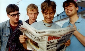 Tickled pink … Blur check out the Grimsby Telegraph's Blur supplement in 1995, from left: Graham Coxon, Dave Rowntree, Damon Albarn and Alex James.