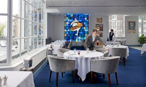 'On a spring day, the first floor space with its stained-glass window in shades of sapphire feels like a room where only good things can happen': Bibendum's dining room.
