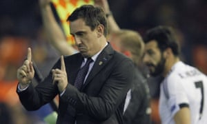 Valencia's coach Gary Neville gestures from the sidelines.