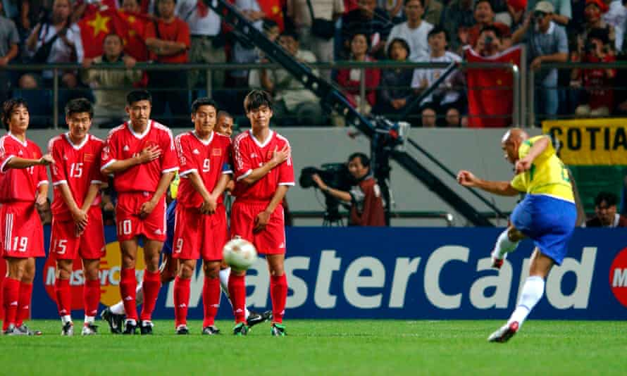 Brazil's Roberto Carlos scores the first goal in a 4-0 win over China at the 2002 World Cup.