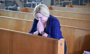 Judith Collins prays inside St Thomas Tamaki church before voting in Auckland.