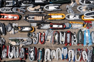 Inflatable dinghies used by migrants to cross the channel from France are stored in a compound in Dover.