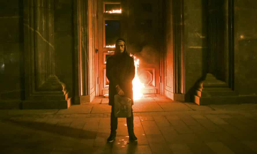 Artist Pyotr Pavlensky holding a petrol  can in front of FSB headquarters in Moscow