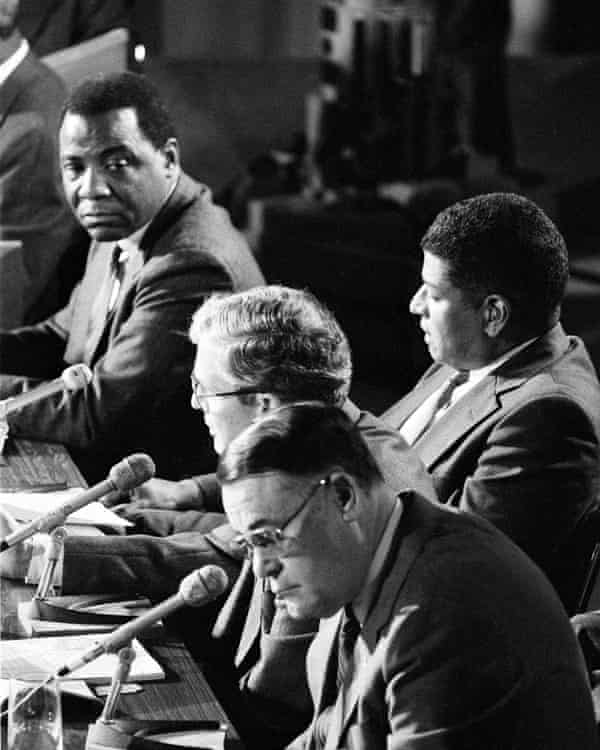 Philadelphia Mayor Wilson Goode, upper left, listens to Fire Commissioner William Richmond answer a question during a session of the special commission investigating the MOVE bombing and fire, Nov. 7, 1985. Behind Richmond is former Managing Director Leo Brooks and in the foreground is Police Commissioner Gregore Sambor.