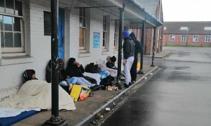 Residents sleep outdoors in protest at conditions inside Napier barracks, where they have been living for months.