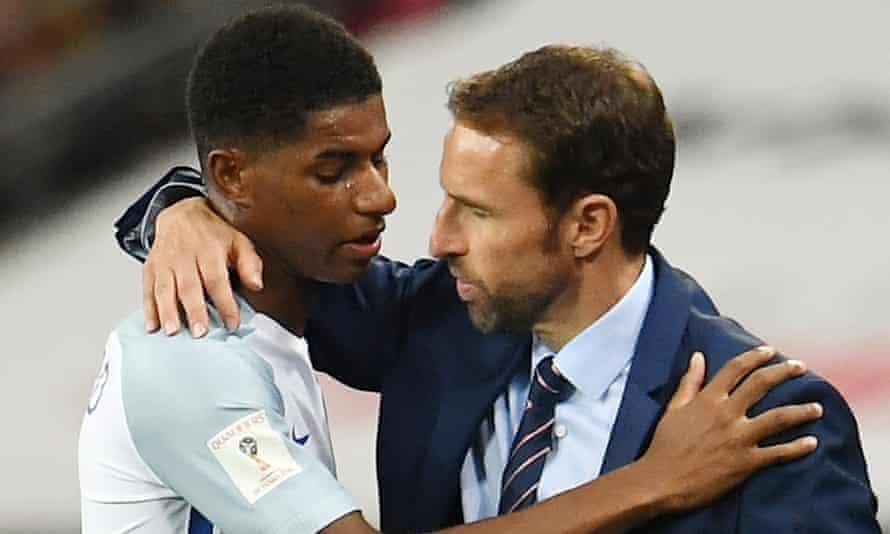 Gareth Southgate, right, hugs England's match-winner against Slovakia, Marcus Rashford.