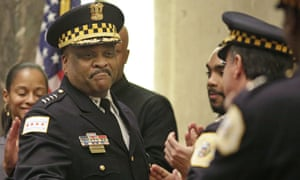 Chicago police superintendent Eddie Johnson shakes hands with other officers at a city council meeting in 2016.