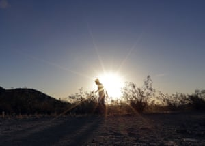 A man runs through South Mountain Park at sunrise to avoid the excessive heat in Phoenix. A record heat wave is rolling into Arizona, Nevada and California, threatening to bring 120F (48.8C) temperatures