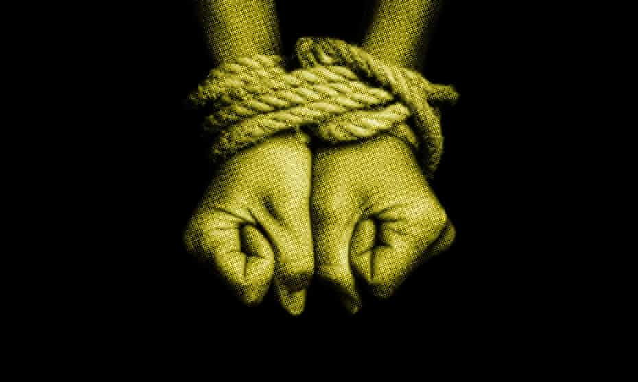 a pair of hands tied together with rope