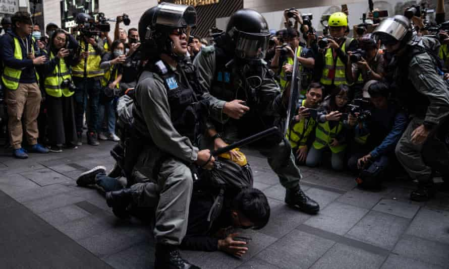 Hong Kong riot police detain a protester outside Chater Gardens during an anti-communism demonstration in January