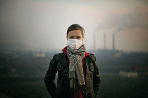 A woman in Norilsk wears a facemask