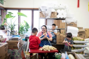 Victoria Chang, center, cuts lemon grass with the help of her nieces and nephews at the Phou Bia Oriental Market located in the Wausau World Market