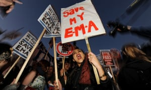 Students with banners protesting at axing of education maintenance grant
