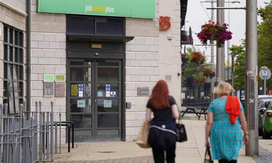 Two women walk past a jobcentre in Middlesbrough, UK.